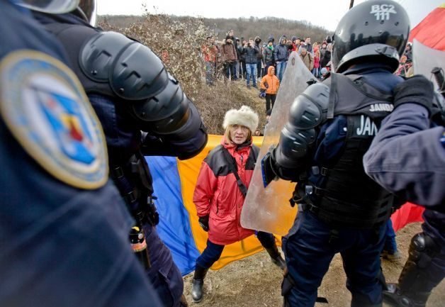 Anti-shale gas exploration protesters scuffle with riot police in Pungesti, north eastern Romania, Saturday, Dec. 7, 2013. Hundreds of villagers destroyed the fences around a plot of land owned by US energy company Chevron, during protests meant to stop shale gas exploration in the area. Photo: Mircea Restea, AP http://www.sfgate.com/news/world/article/Chevron-suspends-shale-gas-exploration-in-Romania-5044475.php#photo-5566843