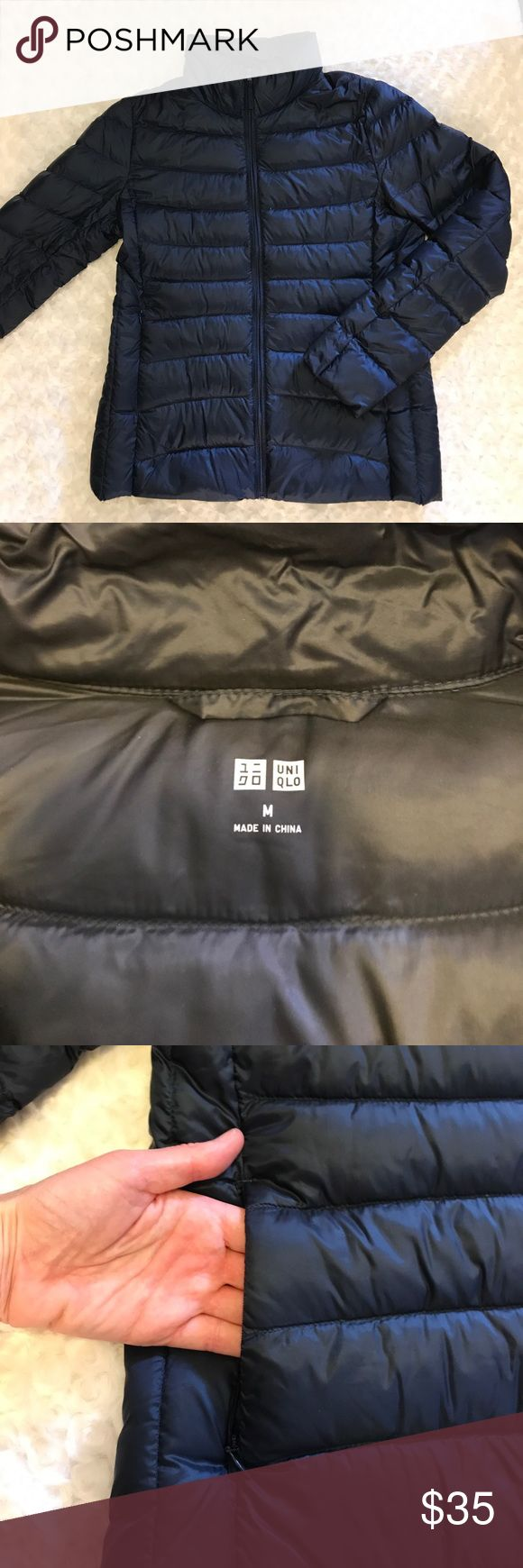 Uniqlo Ultralight Down Jacket Great condition Uniqlo Ultralight Down jacket.  Color navy, size medium.  Zip front, zip side pockets, two large inner pockets.  Size medium.  Few feathers sticking out here and there but that is normal for a Down-fill jacket.  Otherwise great condition and from a smoke-free home.  Rolls up so tiny, takes up hardly any room if you're packing it... you could even fit inside a small purse.  I've loved it and you will too! Uniqlo Jackets & Coats Puffers