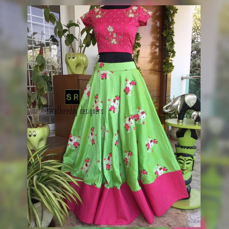 You will fall in love with lovely combination. Beautiful green and pink color combination. Cute green color skirt with floral print and pink color scrop top with floral design hand embroidery thread work.  23 January 2018