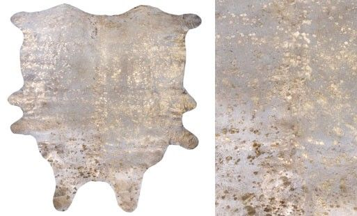 Love my gold-speckled cowhide rug!  Who knew cowhide could be so glam...
