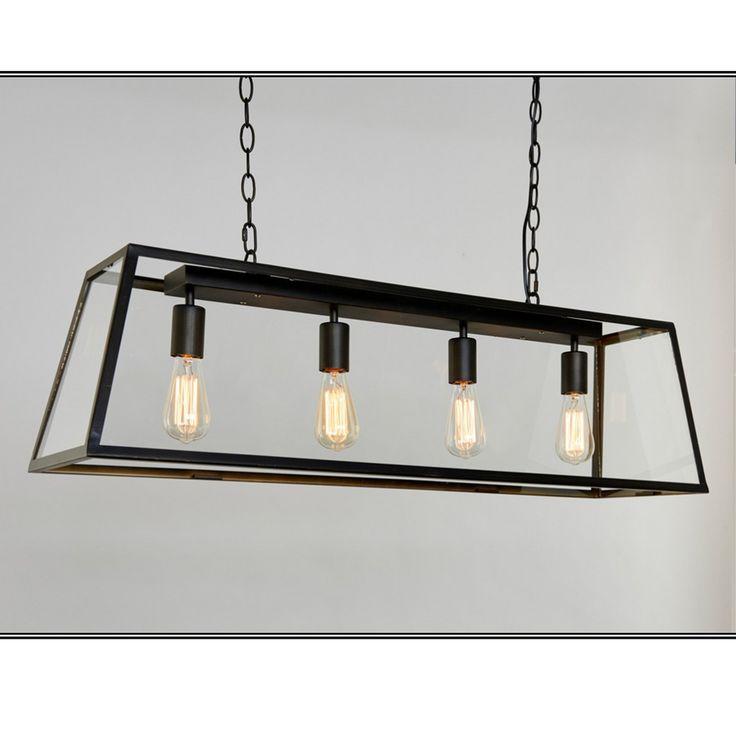 Dovre Taklampe 4 -  Dovre er en meget trendy lampe med enkelt design som passer inn i mange stiler. Lampen har en ramme av metall med sort fargeutførelse og har skjermer av glass på sidene, men ikke i underkant. Opphenget er av dekorativ kjetting og du får den i to størrelser.