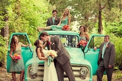 A romantic photo of the wedding party with the sweet ride you rented for the day.