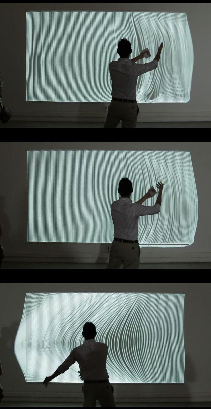 nervous structure by annica cuppetelli and cristobal mendoza. l'usager module numériquement le rideau de trames en reproduisant le geste face à l'écran.