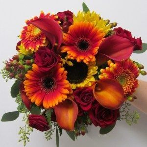 Orange Gerbera Daisy, Sunflowers, Flame Calla Lily, Hypericum, Red Spray Roses and Seeded Eucalyptus.