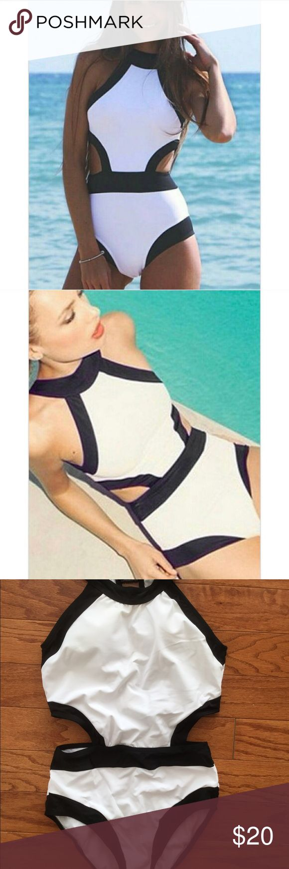 Black and white one piece swim suit One piece swimsuit with cut out sides. Super cute and flattering. Bathing suit is so classy! No brand, listed ASOS for views. ASOS Swim One Pieces