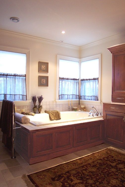 Awesome Cherry Wood Bathroom   Cherry Wood Matching Cabinets Surround The Tub