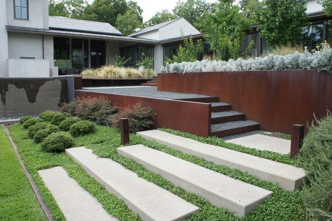 Corten retaining walls and raised concrete steppers Contemporary ...