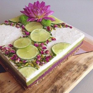 A raw vegan 'cheesecake' to share with my friends tomorrow! Layers of mixed berry creme, pistachio creme & vanilla bean coconut whip, on a crunchy buckwheat & macadamia base. Topped with slices of lime, pistachios & edible rose petals.