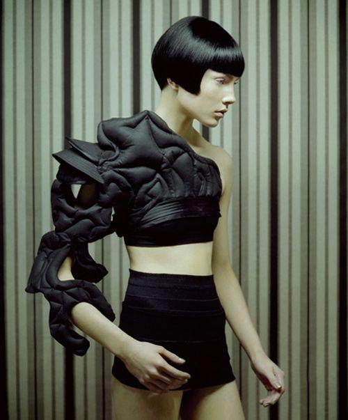 Sculptural Fashion - quilted sleeve detail; three-dimensional textures; futuristic fashion design
