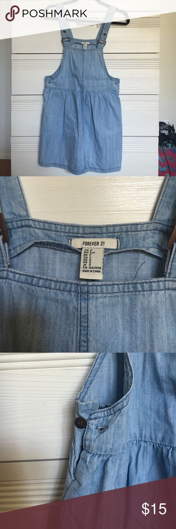 Denim pinafore skirt Overall skirt with adjustable straps. Has buttons on both sides of waist to get in it. Only worn once for a costume. F21, labeled asos for exposure ASOS Dresses Mini