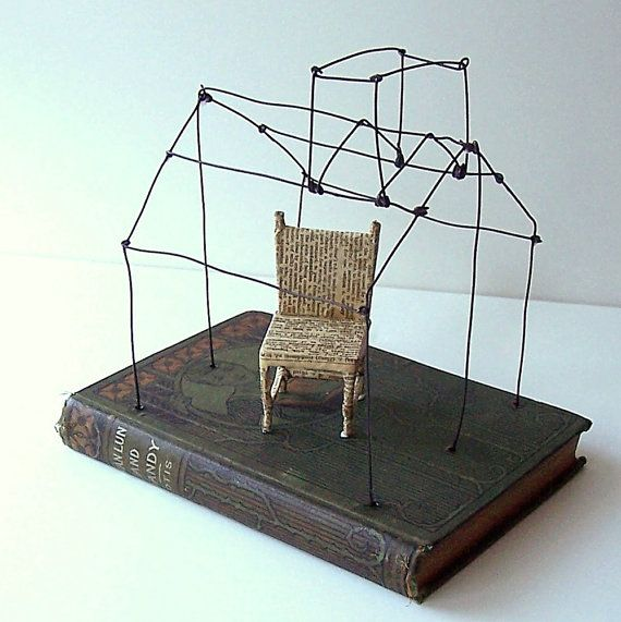 a house of wire with a chair