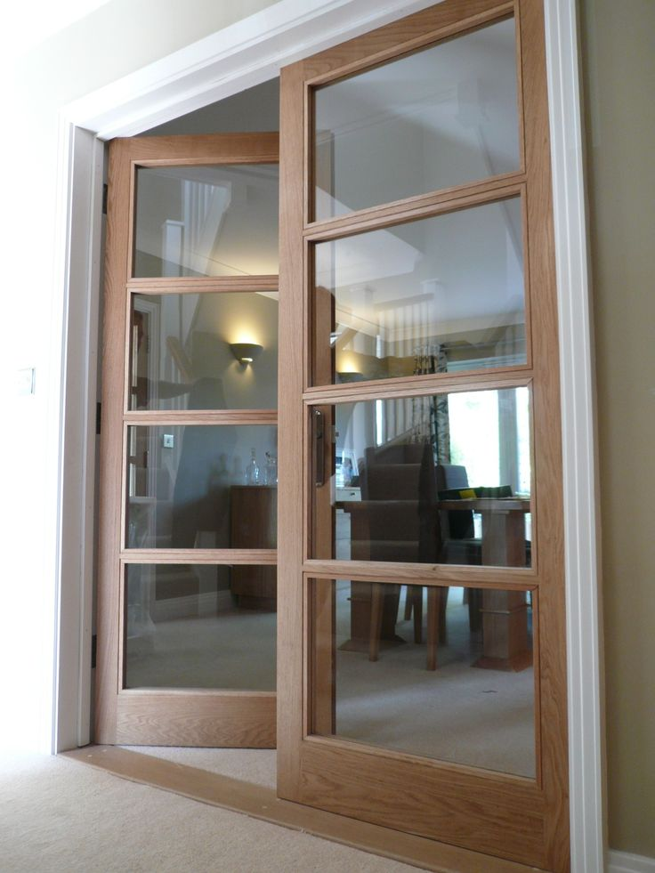 Internal doors made from oak with glass paneling throughout; providing a simple yet elegant transition from living room to dining room.