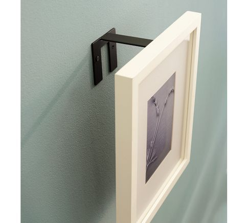 Frame Riser - Designed to bring some frames forward over others.You can overlap frames for a cool wall collage.