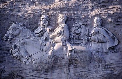 Stone Mountain, Georiga. The largest piece of exposed granite in the world. Best known, however, for the carving on its north face. The carving depicts three figures, Stonewall Jackson, Robert E. Lee, and Jefferson Davis. Three of our most beloved heroes.