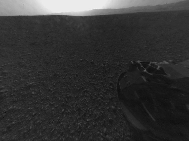 This is the full-resolution version of one of the first images taken by a rear Hazard-Avoidance camera on NASA's Curiosity rover, which landed on Mars the evening of Aug. 5 PDT (morning of Aug. 6 EDT).