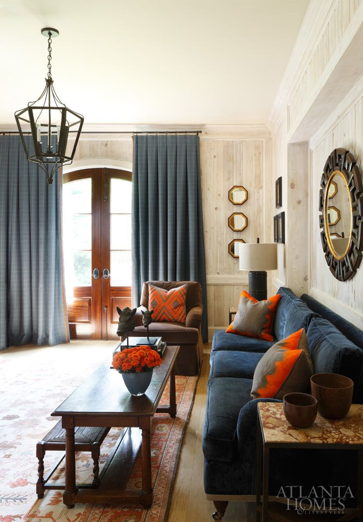 Atlanta Homes & Lifestyles - Practically Perfect -  Beth Webb Interiors. Orange rug w/ Navy, awesome light panelling and cool geometrics. Photo by Mali Azima