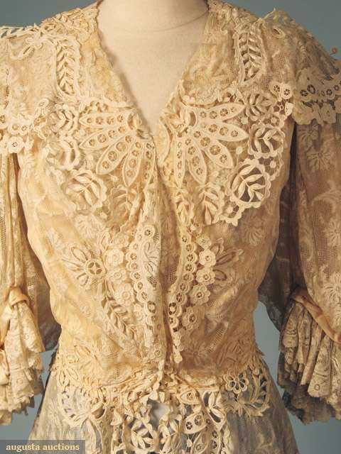 CREAM LACE JACKET, c. 1905. Valenceinnes lace, puffed & flounced elbow length sleeve, bodice fitted to waist w/ long peplum, embroidered eyelet trim on peplum, collar & jacket back, blush lining. Detail front
