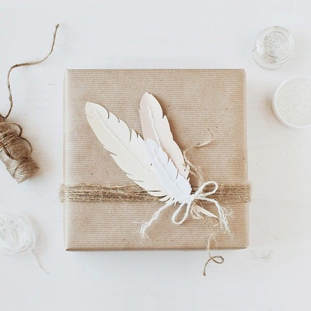 Gift wrapped in kraft paper, twine and feathers