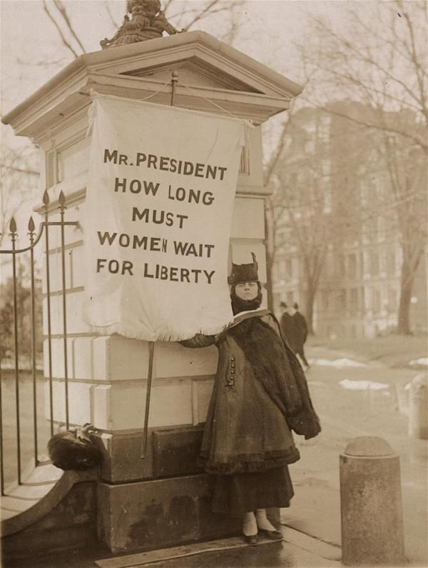 Woman picketing the White House, 1917. From the Records of the National Woman's Party.