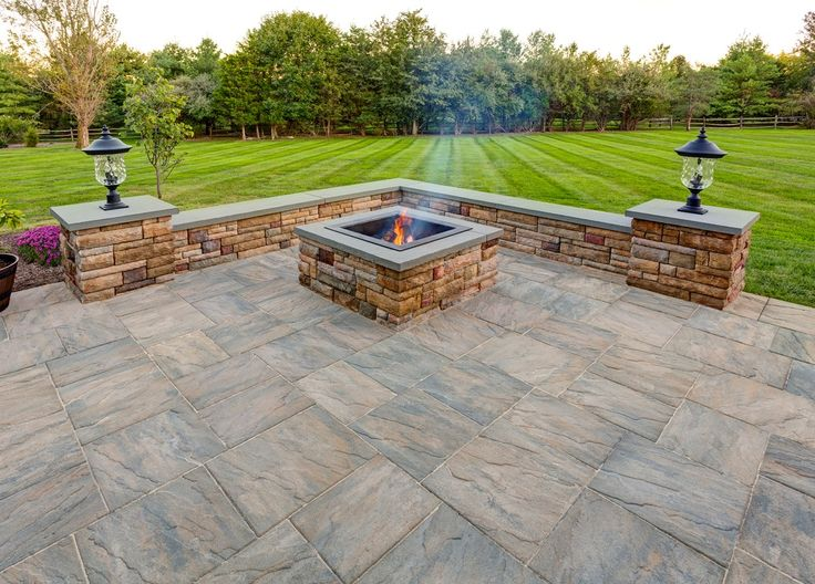 EP Henry pavers in Chiseled Stone patio with custom square fire pit and sitting wall in Cast Stone Wall.