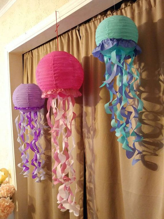 Jelly fish are a great addition to any Little Mermaid or Under the sea birthday party!  This order includes 3 jelly fish made out of paper lanterns and crepe paper. They are about 8 inches in diameter and are about 16 inches long. The jelly fish can be done in any color or combination of colors.  Place the colors you would like for all three Jelly fish in the notes.  *For Little Mermaid or Under the sea centerpieces https://www.etsy.com/listing/386171238/little-mermai...