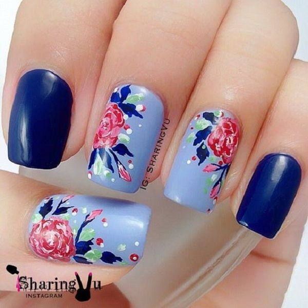 The Blue water colored Nail Art Design. This very pretty blue floral nail art design iis going to be perfect for your denim days. The colorful spray over the blue base is pretty amazing.