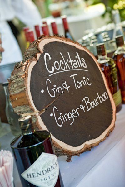 Rustic wedding cocktail hour idea - specialty drinks displayed on painted tree slice {Champagne Wedding Coordination}