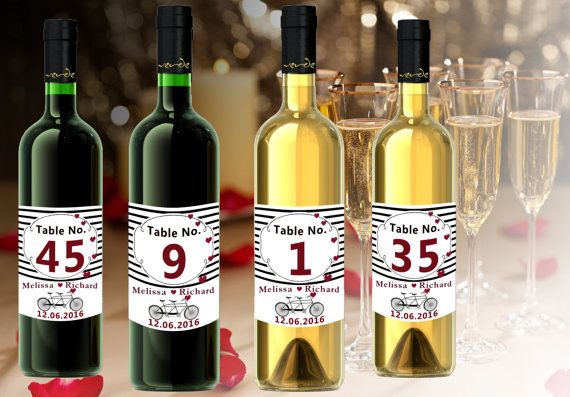 Check out this item in my Etsy shop https://www.etsy.com/listing/270444610/wine-bottle-table-number-labels-modern