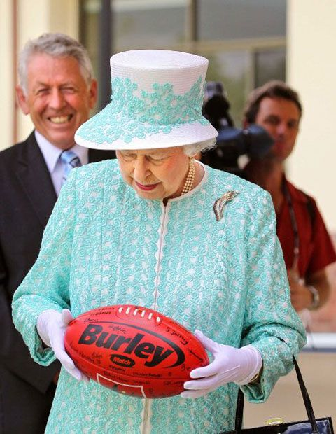 Australia, 2011 - Queen Elizabeth II inspecting an Australian Rules football.