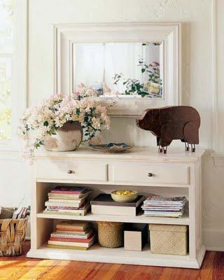 I don't really like the pig but the mirror, flowers, and shelving are a win!