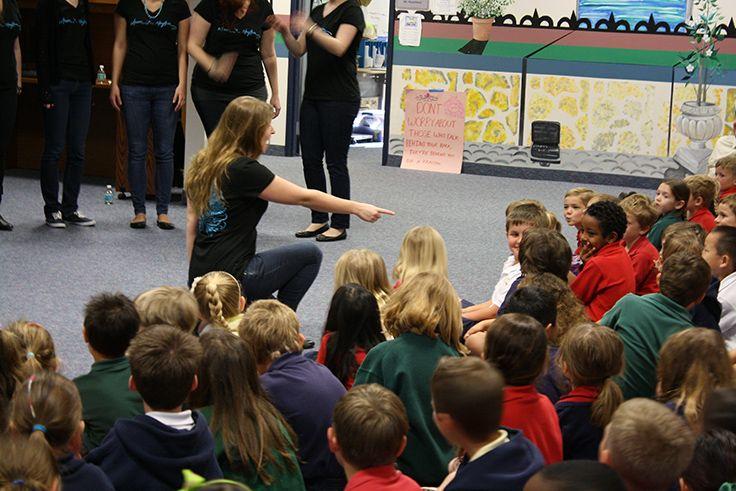 A Whim 'n Rhythm serenades an Intermediate School student