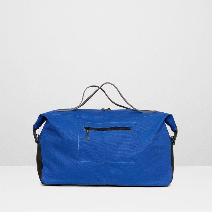 Waxed canvas holdall in blue | Ally Capellino  | Ally Capellino