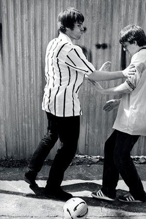 Kevin Cummins' Manchester: Liam and Noel Gallagher playing football in 1994, by Kevin Cummins