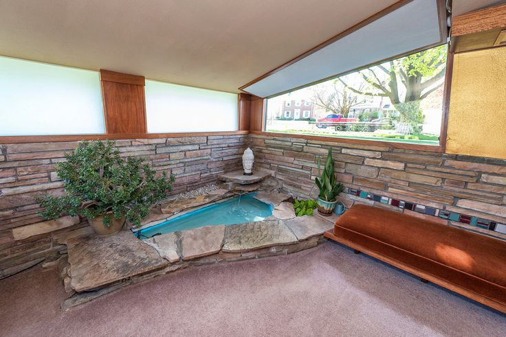 """Midcentury modern home with """"scotch and music"""" room and indoor fountain asks $199K - Curbedclockmenumore-arrow : John Randal McDonald designed the home in 1953"""