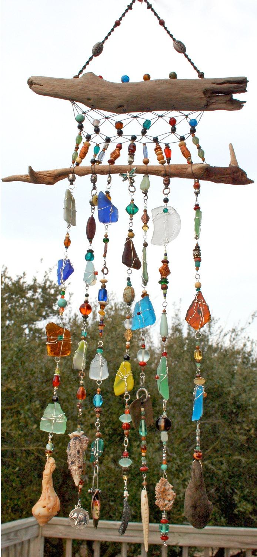 Handmade Sea Glass, Driftwood and Macrame Wall Art Suncatcher. $180.00, via Etsy.