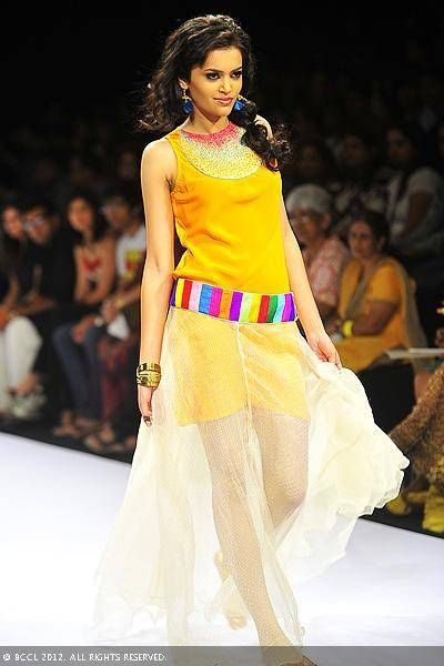 A model showcases a creation by designers Mayank Anand and Shraddha Nigam on Day 3 of the Lakme Fashion Week (LFW) 2012 at Grand Hyatt in Mumbai.