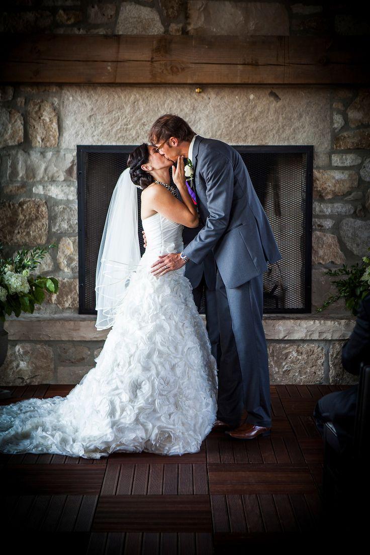 Textured wedding dress, Wedding dress with train, Stone fireplace, Cambridge Mill, Cambridge, Ontario, Canada wedding photography experts | Anne Edgar Photography