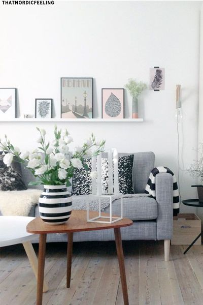 Floating shelf above sofa - mix of pink and grey