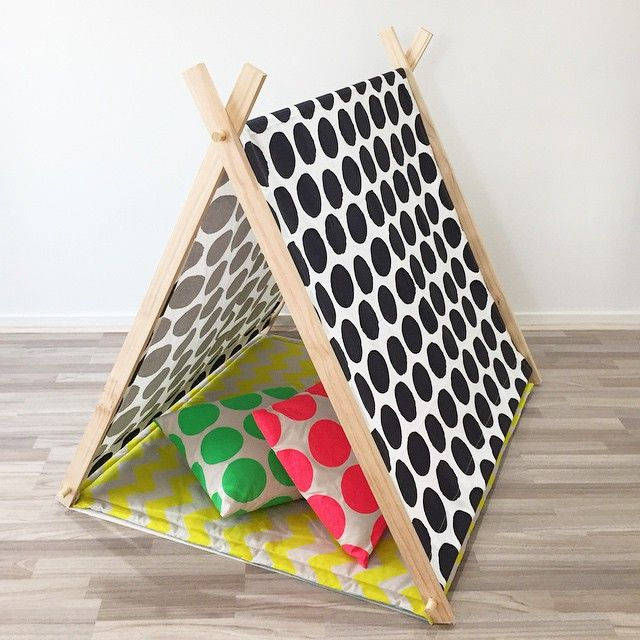 Custom made play tent with nice and bright revisable mat with funky cushions.