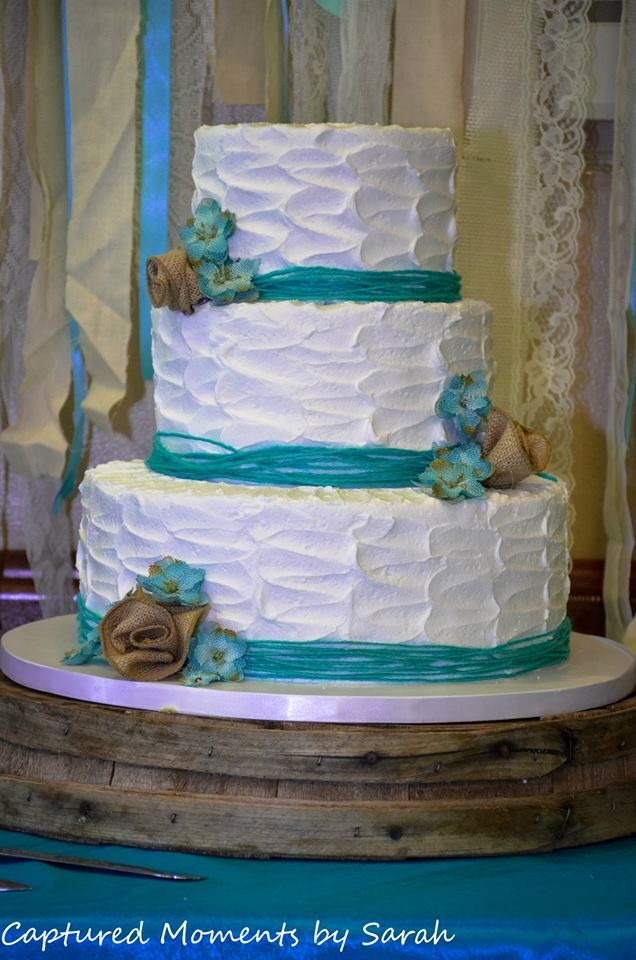 country wedding, aqua ( turquoise ) and burlap wedding it was awesome cake made by Cakes by request in Marsyville, CA