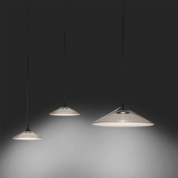 Great Orsa by Artemide is a slim metal stem which flares out at one end to form