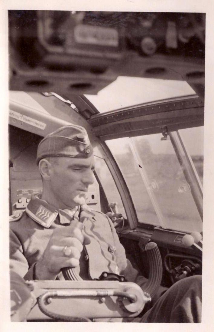 A Luftwaffe Oberfeldwebel in the cockpit