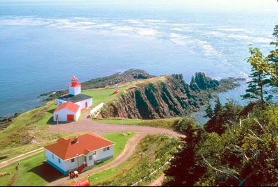 Been there:  stayed overnight at the Cape d'Or Lighthouse in Nova Scotia, Canada (the largest rectangular bldg is the bed and breakfast). Fascinating to watch the tides rush out and in ... a 30 foot difference between low and high tide.