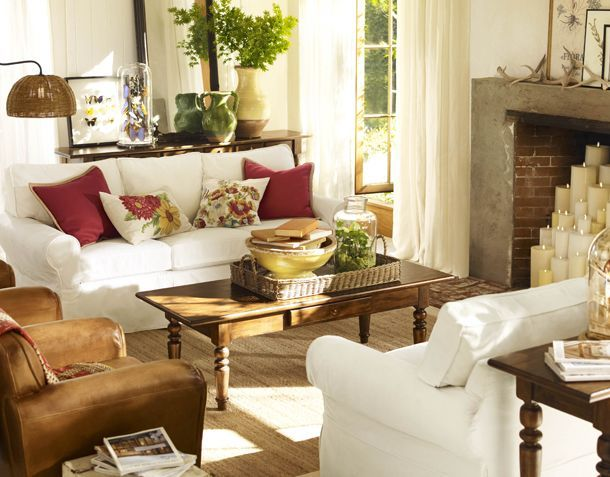 There's something about this Pottery Barn living room that I realy like... I think it's the brightness of the room.  Maybe the pillows.  Beautiful.
