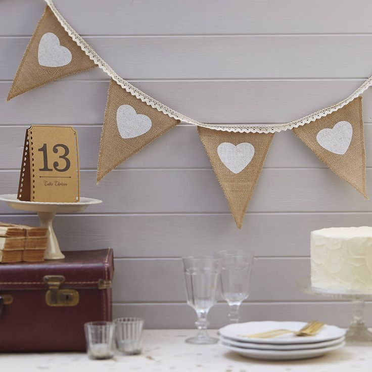 Rustic hessian and lace bunting perfect as a decoration at a wedding or party!Our rustic hessian vintage bunting has printed white hearts and lace ribbon stitched on the top of each flag. Ideal for the wedding reception or outside the church. Other decorative items are also available in the same range such as wooden signs, confetti and guest books. The bunting measures 2.5m length.Hessian and lace. 2.5m length.