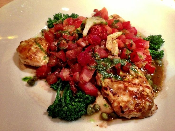 The Cheesecake Factory Tuscan Chicken entree consists of grilled chicken breast topped with tomatoes, artichokes, capers, fresh basil...