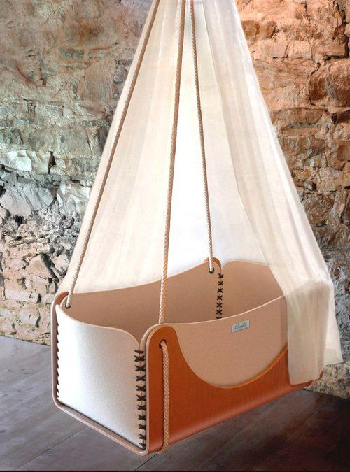 Woodly hanging cradle. beautiful baby furniture made of wool, wood. Stunning materials