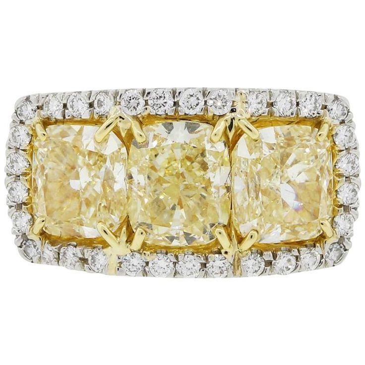 Fancy Yellow Cushion Cut Diamond Halo Ring | From a unique collection of vintage more rings at https://www.1stdibs.com/jewelry/rings/more-rings/