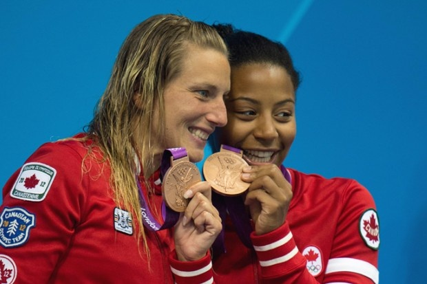 It was Jennifer Abel and Emilie Heymans who delivered Canada's first medal of the London 2012 Olympic Games in 3m synchro diving at the Aquatics Centre Sunday.