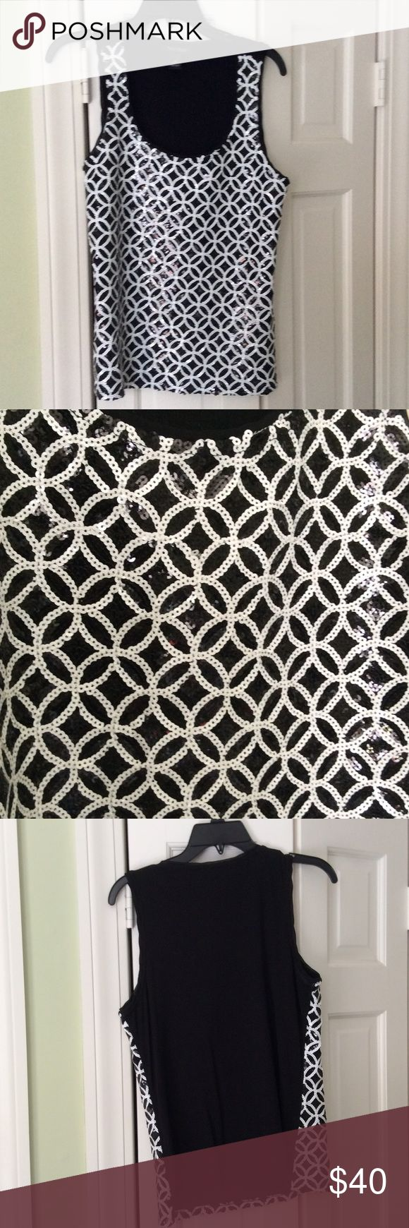 White House Black Market sequined top This black and white sequenced top looks great both for a casual look with jeans or a dressy look with a skirt or slacks. The back is a solid black stretchy fabric. White House Black Market Tops